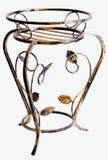 Contributo forgiato del ferro ai POT di fiore Fotografie Stock