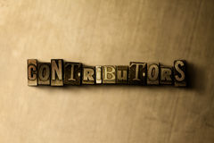 CONTRIBUTORS - close-up of grungy vintage typeset word on metal backdrop Stock Images