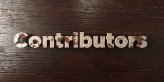 Contributors - grungy wooden headline on Maple  - 3D rendered royalty free stock image Royalty Free Stock Photos