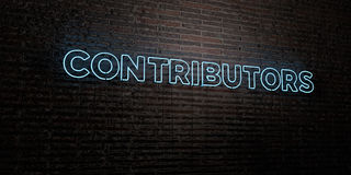 CONTRIBUTORS -Realistic Neon Sign on Brick Wall background - 3D rendered royalty free stock image Stock Photo