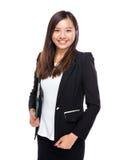 Control asiático de la mujer de negocios con el tablero Imagenes de archivo