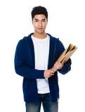 Control asiático del hombre joven con la carpeta Imagenes de archivo