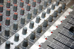 Control board sound mixer. Details of the control board sound mixer Royalty Free Stock Photo