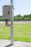 Control box and electric post in the park. Stock Images