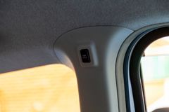 Control button for automatic opening of car door on a central drain stock photos