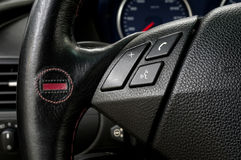 Control buttons and manual gear lever on steering wheel. Stock Image
