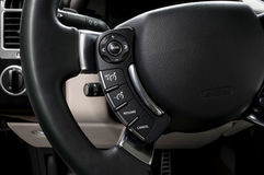 Control buttons on steering wheel. Stock Photo