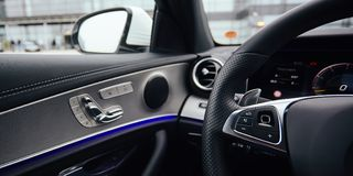 Control buttons on steering wheel. Car interior. Shallow dof Stock Photography