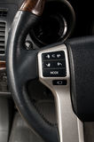 Control buttons on steering wheel. Stock Photos