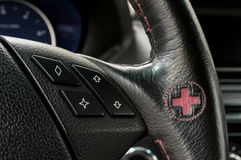 Control buttons on steering wheel. Royalty Free Stock Image