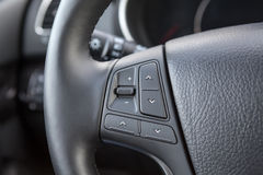 Control buttons on steering wheel of car Stock Images