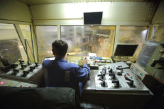 Control cabin inside with worker. Royalty Free Stock Photos