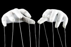 Control concept, gloved hands with cord. Control concept, hands in white gloves with ropes on a black background stock photos