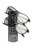 Control of 3d TV glasses. Two pairs of 3D glasses and remote control TV. Isolate on white background Royalty Free Stock Photography