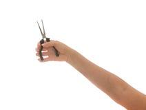 Control de la mano de la mujer alicates negros y amarillos aislados Fotografía de archivo