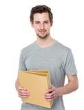 Control del estudiante con la carpeta Foto de archivo libre de regalías