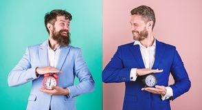 Control and discipline. Build your self discipline. Men business formal suits hold alarm clocks. Lack of self discipline. In time management leads people to stock photos