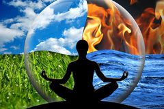 Control emotions. Female yoga figure in a transparent sphere, composed of four natural elements (water, fire, earth, air) as a concept for controlling emotions Royalty Free Stock Image