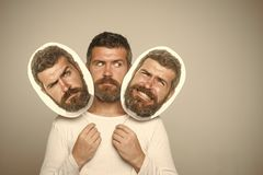 Control of emotions. Feeling and emotions. Man with long beard and mustache. Guy or bearded man on grey background. Hipster with sad face hold portrait Stock Photos