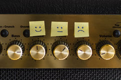 Control emotions happy sad neutral. Taken using a guitar amplifier in the house Stock Photography