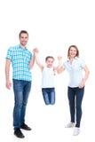 Control feliz de los padres de la mano de su hija Imagen de archivo
