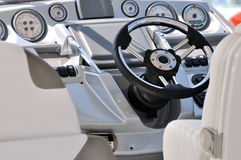 Control gage and steering wheel of yacht. Steering wheel and gage in small yacht, shown as entertainment, holiday or marine activity royalty free stock image