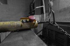 Control for an indoor crane hoist in a factory workshop stock images