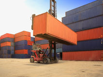 Control loading Containers box from Cargo freight ship Stock Photo