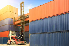 Control loading Containers box from Cargo freight ship Royalty Free Stock Photos