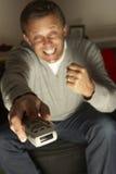control man remote television using Στοκ φωτογραφίες με δικαίωμα ελεύθερης χρήσης