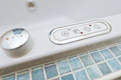 Control panel on bathtub with buttons stock photo