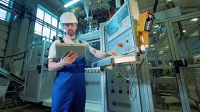 Control panel in being navigated by a male engineer stock video