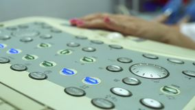 Control panel of ultrasound equipment. Control panel with buttons of ultasonography equipment. Doctor using the apparatus. Close-up stock video footage