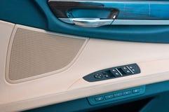 Control panel in a car door. Control panel in a luxury car door Stock Photography