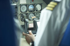Control panel on a cesna airplane. Controls with a pilot in the background Royalty Free Stock Images