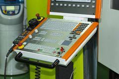 Control panel of cnc machining center at workshop. Close up control panel of cnc machining center at workshop stock photo