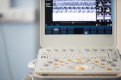 The control panel and the keyboard of the ultrasound device. Gray and orange button of the keyboard of the device for ultrasound examination against the royalty free stock photos