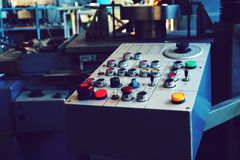 The control panel of the machine with cnc for processing material at the machine-building enterprise. stock photography