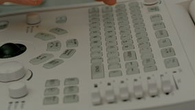 Control panel of medical device with doctor's hand. People stock video
