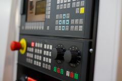 Control panel of modern CNC lathe machine. Selective focus royalty free stock photo