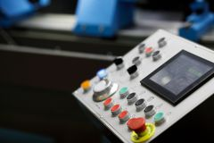Control panel of modern industrial CNC equipment. Selective focus royalty free stock photography