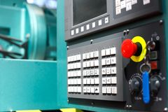 Control panel of modern metalworking cnc machine. Center. Selective focus royalty free stock photography