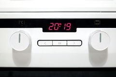 Control panel of modern white kitchen electric stove Stock Photo