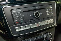 The control panel of the multimedia system, radio, telephone, heated seats and ventilation, emergency stop button and a hole for royalty free stock images