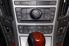 The control panel of the multimedia system, radio, telephone, heated seats and ventilation, emergency stop button and a hole for stock photo