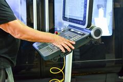 The control panel of the program of work on the control panel of the precision CNC machining center, the processing of the manufac stock image