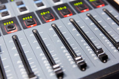 Control panel at recording studio or radio station. Technology, electronics and equipment concept - control panel at recording studio or radio station stock photography