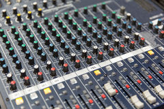 Control panel at recording studio or radio station. Technology, electronics and equipment concept - control panel at recording studio or radio station stock image