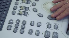 Control panel of ultasonography equipment. Control panel with buttons of ultasonography equipment. Doctor using the apparatus. Close-up stock footage