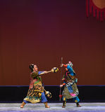 """The control and the pike Pratia-Peking opera """"Little Worriors of Yeuh's family"""" Royalty Free Stock Image"""
